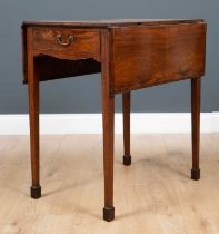 A George III mahogany small size Pembroke table the quarter veneered top with central boxwood