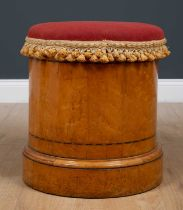 A Victorian cylindrical satin birch commode stool with overstuffed upholstered seat, lifting to
