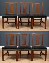 A matched set of six George III and later mahogany dining chairs with pierced splats and green