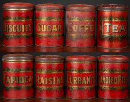 A set of eight 19th century storage tins, red enamelled with bold gold label within scrolling