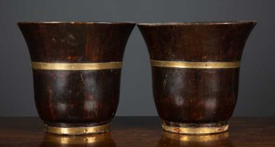 A pair of stained softwood turned waste paper baskets with brass bindings and flared rims, each 26.