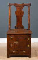 A George III Irish oak country chair possibly from Country Antrim, with solid bar shaped splat