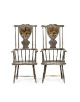A pair of possibly George III Scottish grey painted Windsor armchairs, the shield shaped splats
