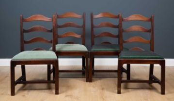 A set of four George III country made mahogany ladder back dining chairs of plain form with inset
