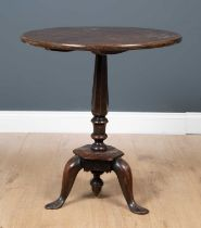 A George III country made mahogany circular tilt top occasional table with octagonal column