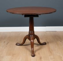 A George III mahogany circular tilt top occasional table, with box support to the circular table