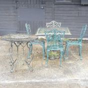 A green painted cast iron garden table,