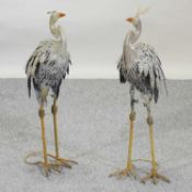 A pair of painted metal garden models of birds,