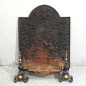 A cast iron fire back,