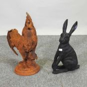 A rusted metal model of a cockerel, together with a model of a hare