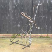 A black painted wrought iron weather vane,