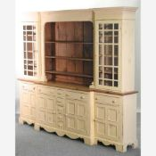 A large 20th century cream painted and pine breakfront dresser,