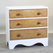 A painted and pine chest of drawers,