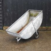 A galvanised water barrow,