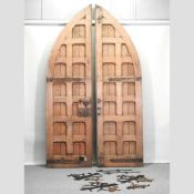 A pair of large antique pitch pine gothic style doors