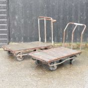 Two flat bed trolleys, together with another
