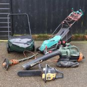 A large collection of garden tools,