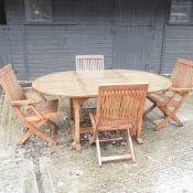 A teak extending garden table,