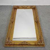 A large modern gilt framed wall mirror,