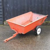 A red garden trailer,