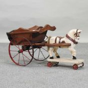 A 20th century children's pull-along model horse and cart