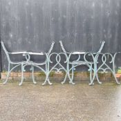 Two pairs of metal garden bench ends,