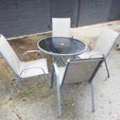 A glass top circular garden table,