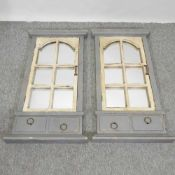 A pair of grey painted shutter wall mirrors,