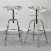 A pair of painted metal tractor seat stools