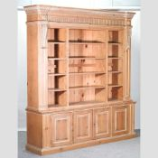 A large modern pine library bookcase,