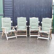 A set of four folding garden chairs,