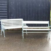 A cast iron and slatted wooden garden bench,