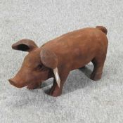 A rusted metal model of a pig