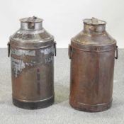A pair of metal milk churns
