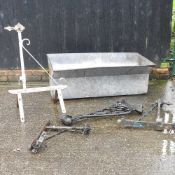 A galvanised tank, together with various metal brackets