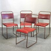 A set of four mid 20th century tubular metal stacking chairs