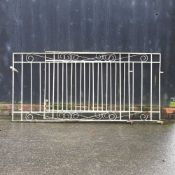A pair of French grey painted wrought iron garden gates,
