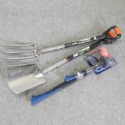 A stainless steel garden fork and spade