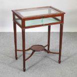An early 20th century mahogany bijouterie table