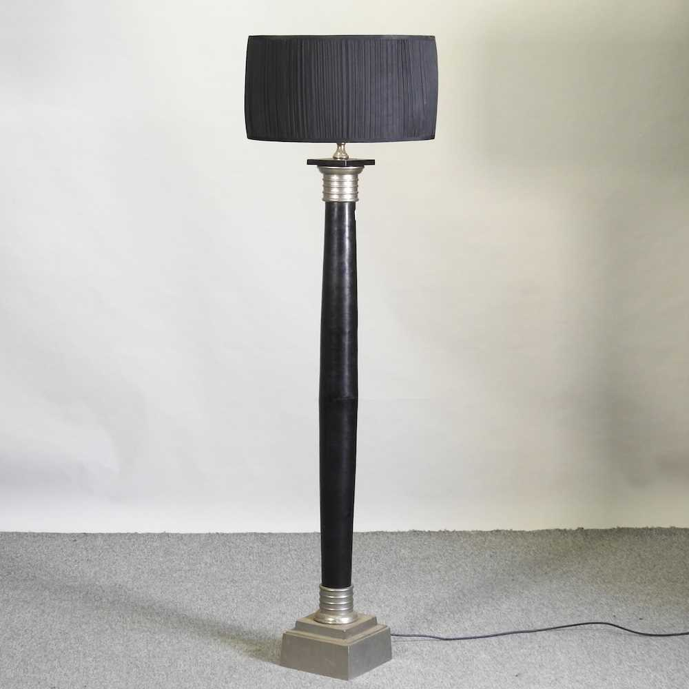 A modern black painted standard lamp and shade