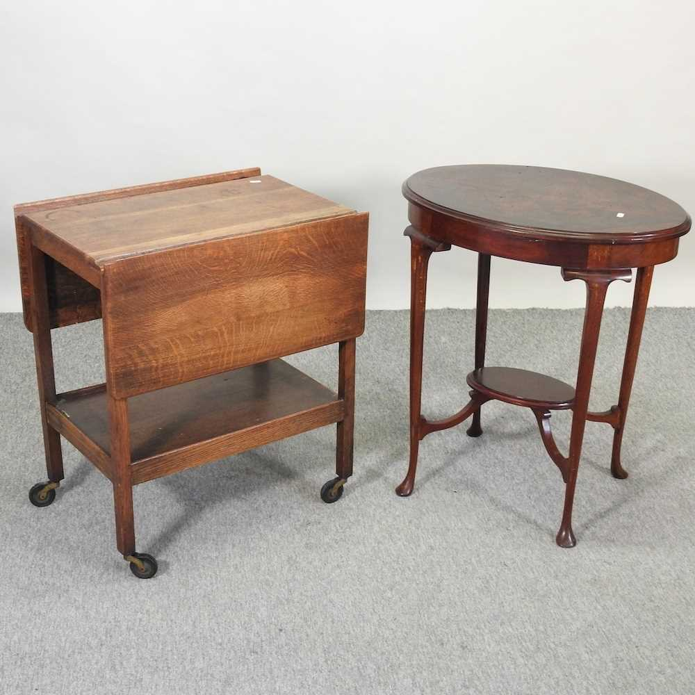 An Edwardian mahogany two tier occasional table