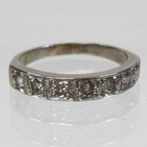 An 18 carat white gold diamond half hoop eternity ring