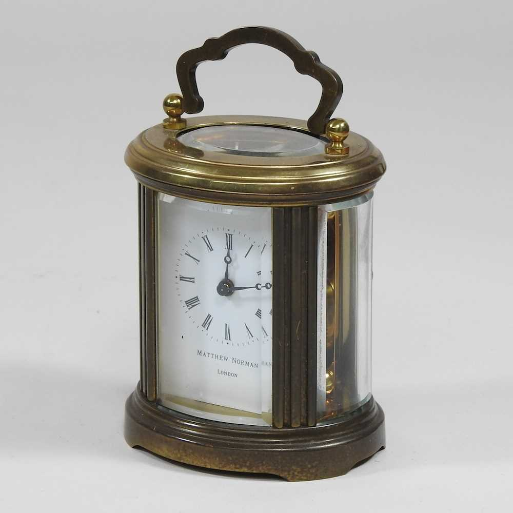 A small brass cased carriage clock