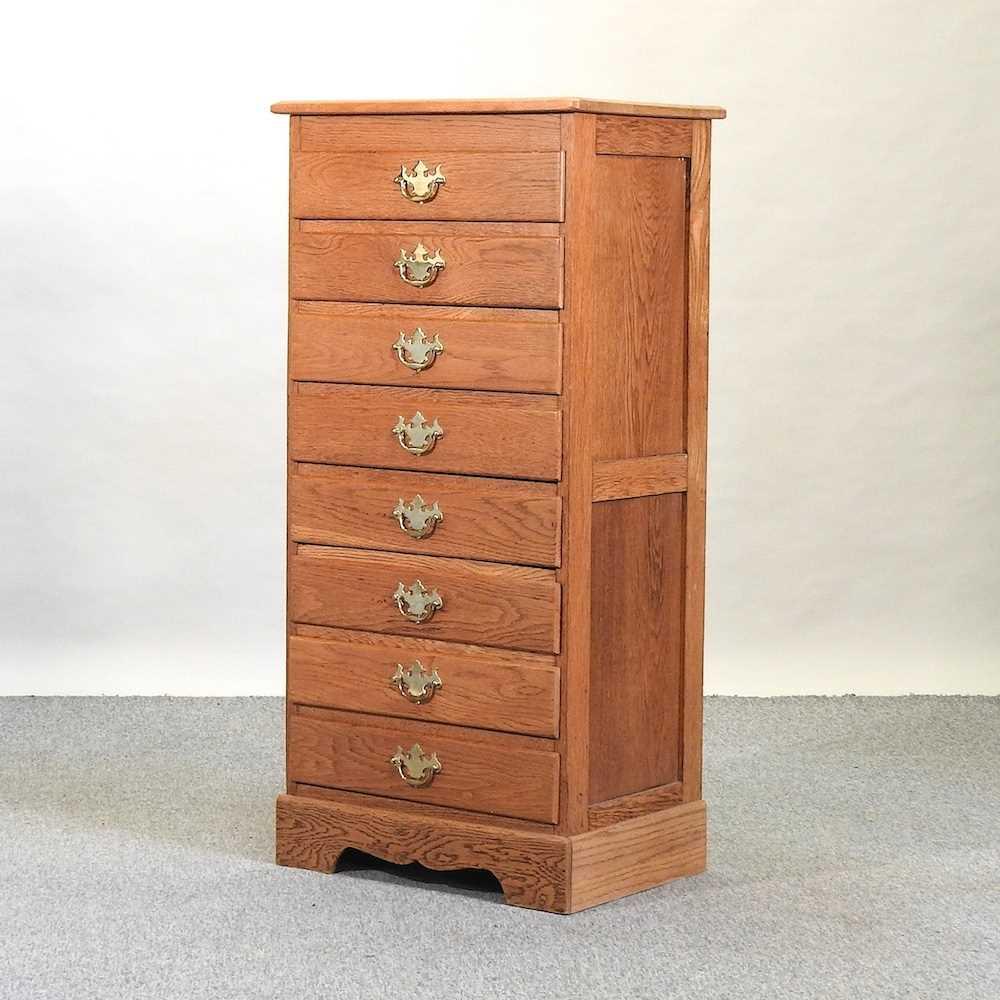 A modern narrow oak chest of drawers
