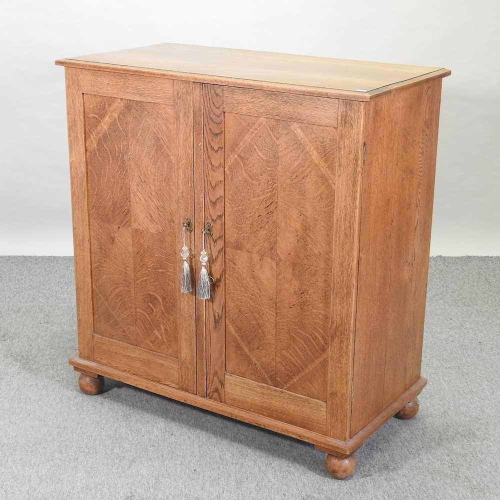 A 1920's light oak cabinet