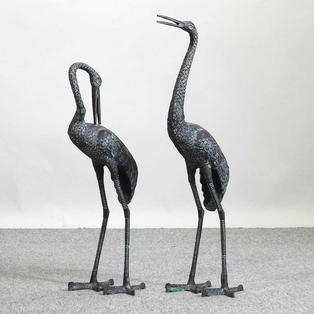 A modern verdigris garden model of a crane,
