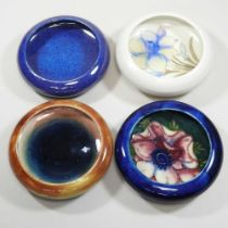 A collection of four Moorcroft pottery pin dishes