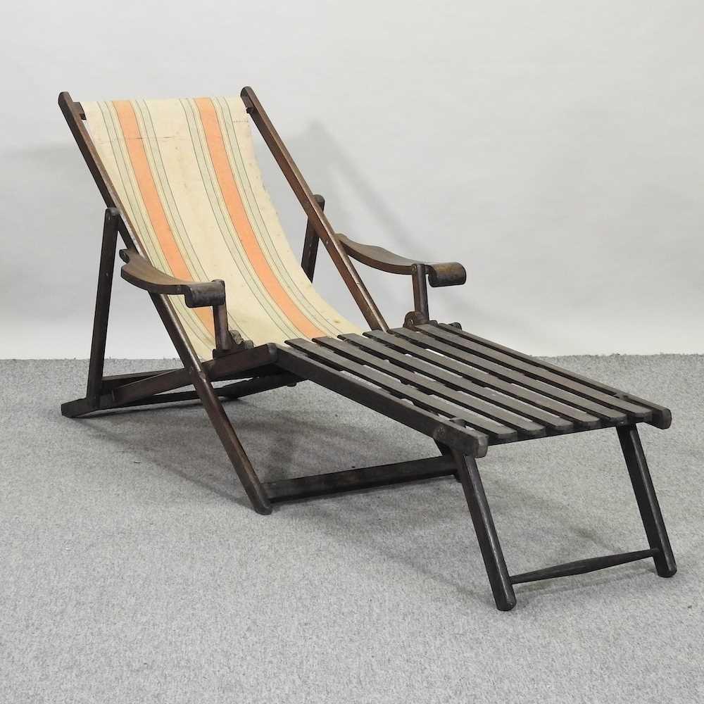 A folding wooden deck chair