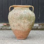 A terracotta olive pot