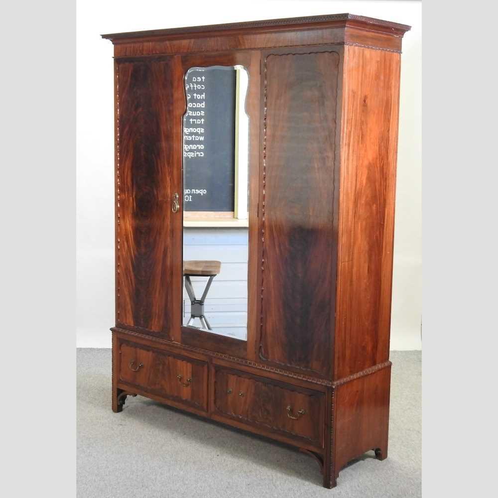 An Edwardian mahogany wardrobe